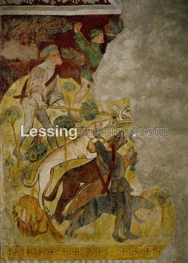 """Hunters and dogs have cornered a boar.From a mural showing a medieval hunt in the woods around Runkelstein castle,in the presence of Margarete Maultasch (""""satchel mouth""""),countess and ruler of Tyrol.Hunting was a favourite sport for knights and ladies alike."""