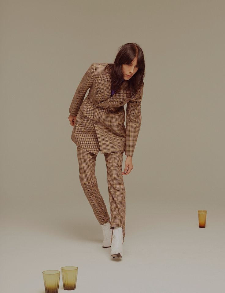 The model wears Balenciaga jacket and pants with boots also from the brand