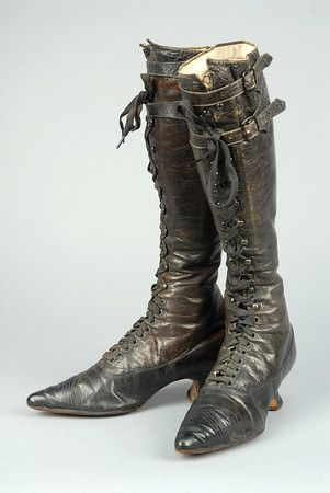 UNUSUAL CAMMEYER HIGH LACING BOOTS, 1890s. Deep brown leather having black toe Louis heel, knee high shaft having speed laces and pair of buckles at top applied with spade shaped leather straps. Labeled on sole