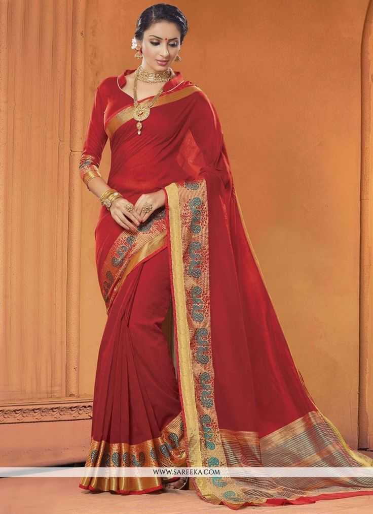 This pretty piece is a fairy tale that begins to unfold as you reveal your beauty in it. Get the simplicity and grace with this maroon cotton   classic saree. This attire is encrafted with digital pri...