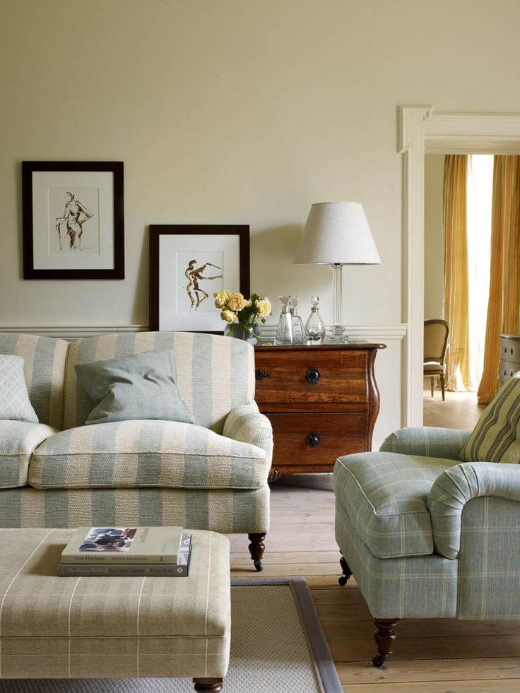 Colefax And Fowler's Branton Stripr (couch), Fordham (left pillow on couch), Blakeney (left pillow on couch), Blakeney Check (ottoman), Hemsby Check (chair), Burnham Stripe (pillow on chair) #colefaxandfowler #textiles #fabrics