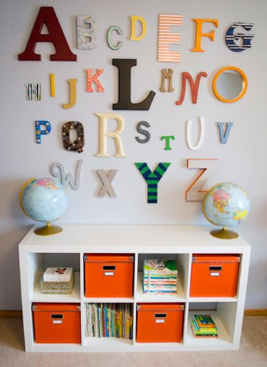 Idea for a baby shower:  Give each guest a letter to paint (keeping it within certain hues that will go with the nursery), then hang them like so!