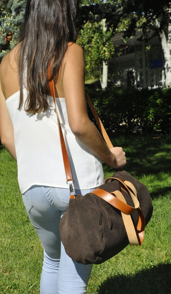 LEATHER DUFFLE BAG This beautiful duffle - overnight bag is made with first quality Spanish leather, one by one, 100% handmade made what makes it unique.  It can be used as a tote bag or as a crossbody bag as you can see in the photos.  It has a pocket inside big enough to carry your mobile phone, keys or something like that so you wont have to spend time looking for they.  This beautiful overnight bag is perfect for a weekend travel or for airplane hand luggage   MATERIALS:  First quality…