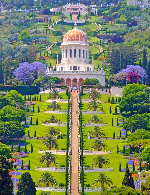 The amazing Ba'hai gardens in Haifa, Israel. Located on a steep hillside, this formal garden cascades down in symmetrical terraces full of color and unique forms. Open to the public, but make a reservation to visit.