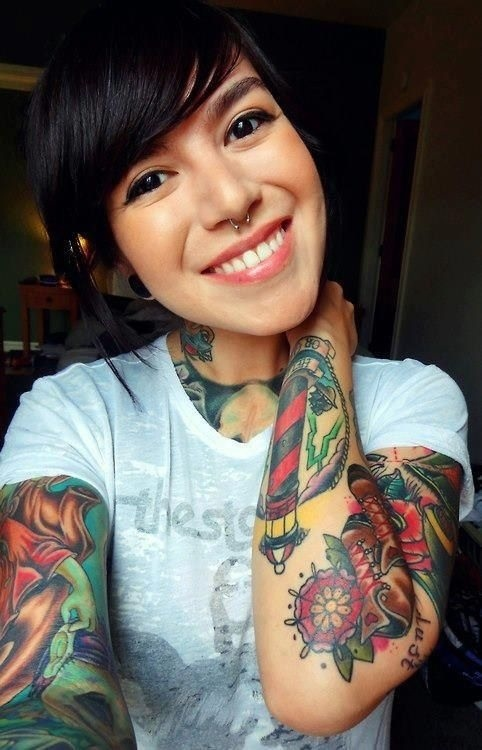 Loooooove looooooove her tattoos and the color of them. Of course I love the septum piercing because that's what I have!
