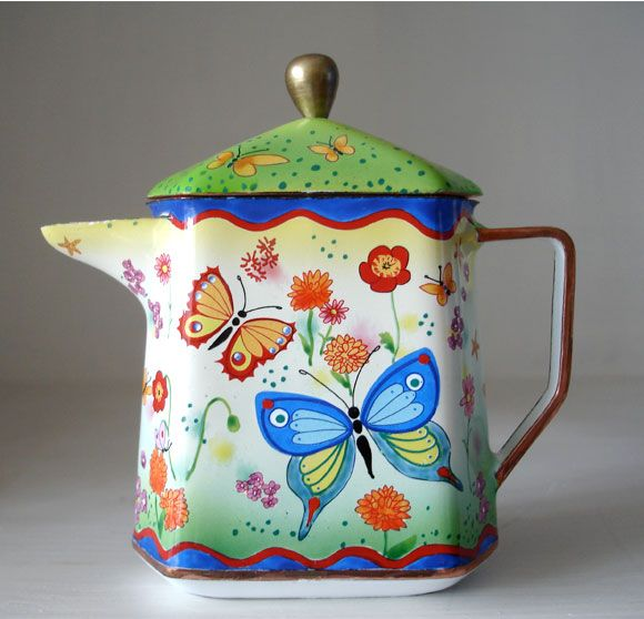'Marigolds' miniature enamel teapot. Hand painted in China. Glass fused to a metal base.