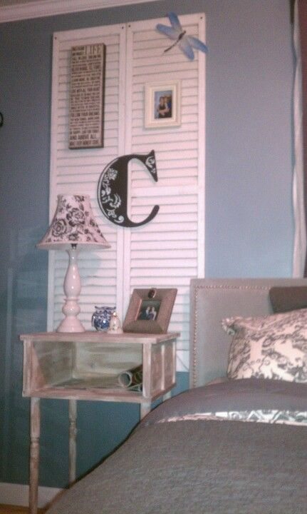 Home made night stand, white and gray washed with old wooden shutters on the wall