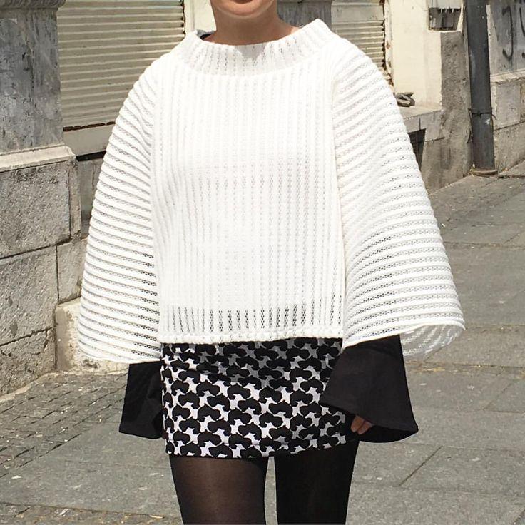 White jumper and black & white mini skirt