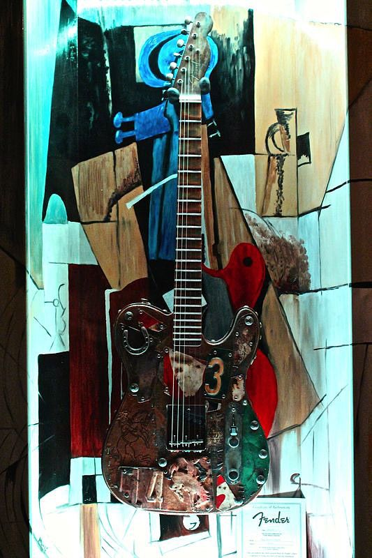 "ZAAX wall guitar display ""Rythm ... Rock, Jazz, Blues"" and Fender Masterbuilder Dave Newman"