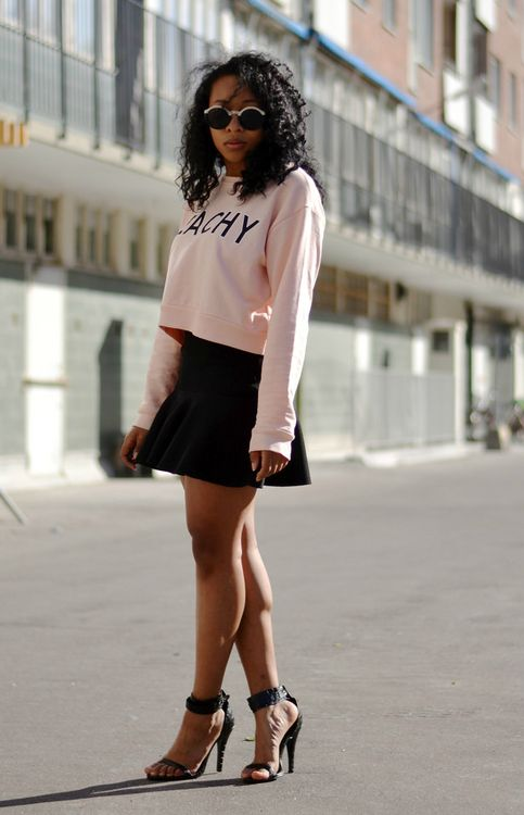Shop this look on Lookastic:  http://lookastic.com/women/looks/pink-print-cropped-sweater-and-black-skater-skirt-and-black-leather-heeled-sandals/2988  — Pink Print Cropped Sweater  — Black Skater Skirt  — Black Leather Heeled Sandals