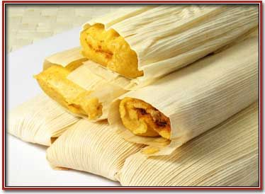 Tamales  Nothing says holidays to many New Mexicans like a warm tamale. Unwrapping the tamale is like unwrapping a little present. Tamales consist of a cornmeal dough made from hominy (called masa) and are usually filled with sweet or savory filling, wrapped in corn husks and steamed until firm. Tamales were one of the staples found by the Spanish when they first arrived in Mexico.