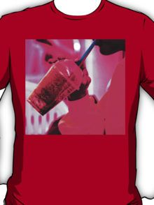Surreal image of young woman drinking ice drink with straw T-Shirt