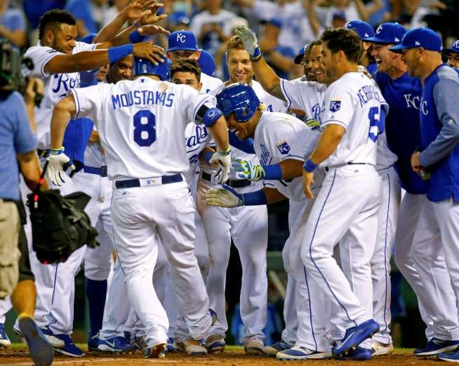 ROYAL CELEBRATION:    Royals players congratulate designated hitter Mike Moustakas at home after his walk-off home run against the Astros in the ninth inning on June 6 in Kansas City, Mo. The Royals won 9-7.