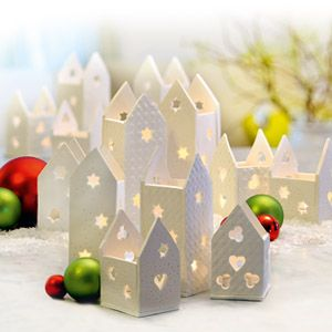 Create these cute buildings out of FimoAir Light for advent calendar gifts or add tealights to create a wonderful city of light.