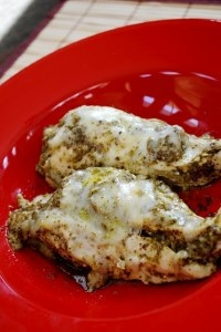 Baked Pesto Chicken http://www.food.com/recipe/baked-pesto-chicken-23425 or http://www.mykitchenescapades.com/2012/02/baked-pesto-chicken.html or http://www.kalynskitchen.com/2010/09/easy-recipe-for-baked-pesto-chicken.html