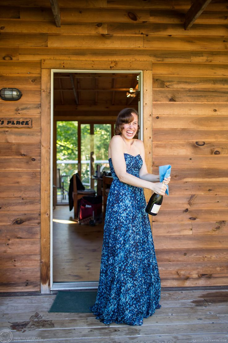 Summer Camp Wedding, Camp Manitou, Parry Sound - sister-of-the-bride / maid of honour popping champagne #sweetheartempire #weddingphotojournalist #seeandbeseen with #loveandauthenticity