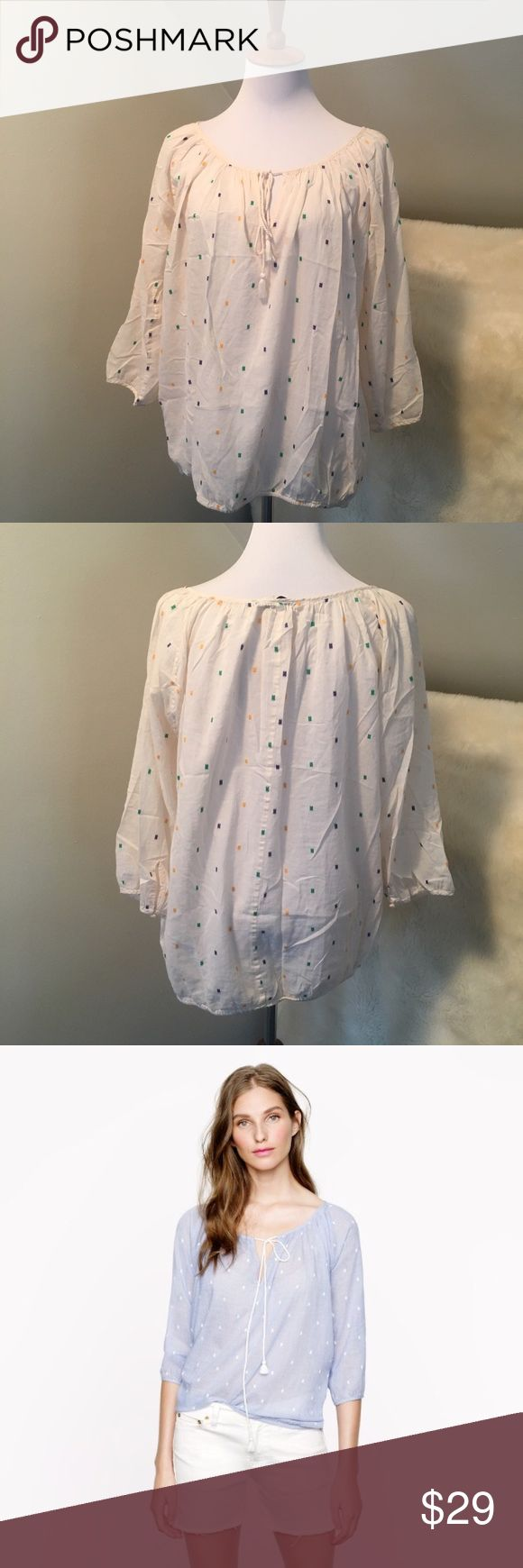 """J. Crew Chambray Square Dot Peasant Top Really pretty lightweight loose fitting cotton blouse. Elastic bottom and sleeves. Great condition. """"Dainty embroidered dots. It's perfected with tailored touches like mother-of-pearl buttons and a swingy little tassel at the neckline for the perfect mix of relaxed and refined. This top was designed to be worn as a beach cover-up—if you'd like to wear it as a top around town, we suggest sizing down."""" Bust is 22"""" across so it would be loose on a medium…"""