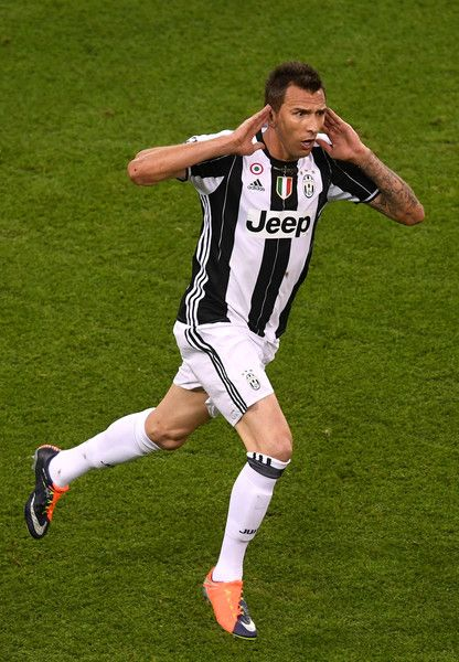 Mario Mandzukic of Juventus celebrates scoring his sides first goal during the UEFA Champions League Final between Juventus and Real Madrid at National Stadium of Wales on June 3, 2017 in Cardiff, Wales.