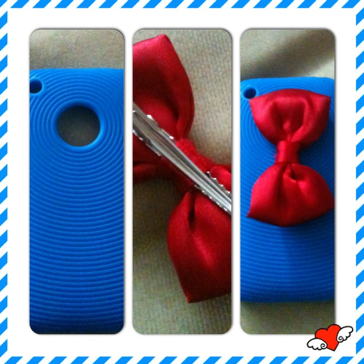 1. Buy a blue phone case 2. Buy a red hair bow with a clip 3. Clip the bow in the hole of the phone case, and you have a beautiful homemade phone case.