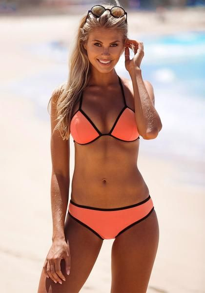 Summer Style // Strut at the beach with style in this orange bikini set.
