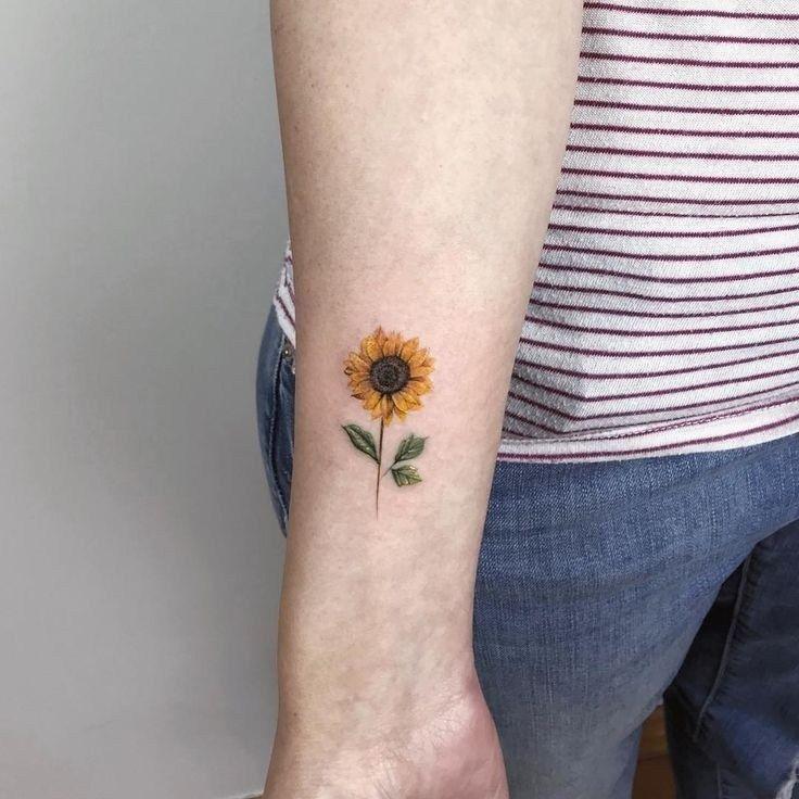 Minimalist Tiny Tattoo Ideas To Look Beautiful 23 Sunflower Tattoo On Wrist Beautiful Flower Tattoos Sunflower Tattoo