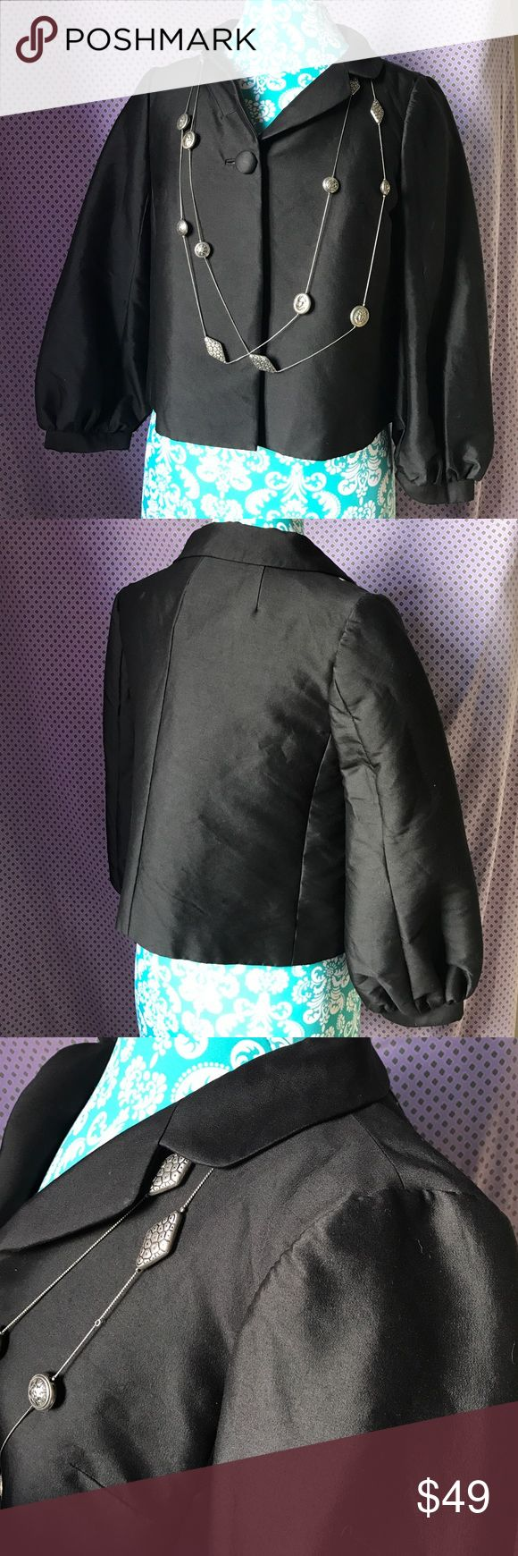 Banana R. Opera Structure Silk Architecture Blazer Excellent, new condition. No stains rips snags or holes. Well fit. Bus starts. Fully lined with polkadot inside. Three-quarter sleeve. Bell sleeve with gathers. 64% silk and 36% wool outer fabric. Inside lining is 50% nylon and 50% acetate. Artsy. Vamp. Museum gear. Professional work suit separate. Kitty cat Lolita cover up. Artsy. Basic. Listeriosis. Cape style. Peter Pan v neck color. Single large button closure in front. OPERA nIGHt…