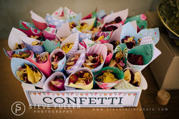 Confetti cones in a wooden box ~ A colourful, traditional, floral country village fete wedding in Kent