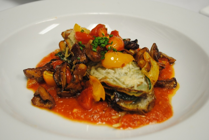 Potato lasagna with spinach, wild mushrooms and roasted tomatoes. # ...