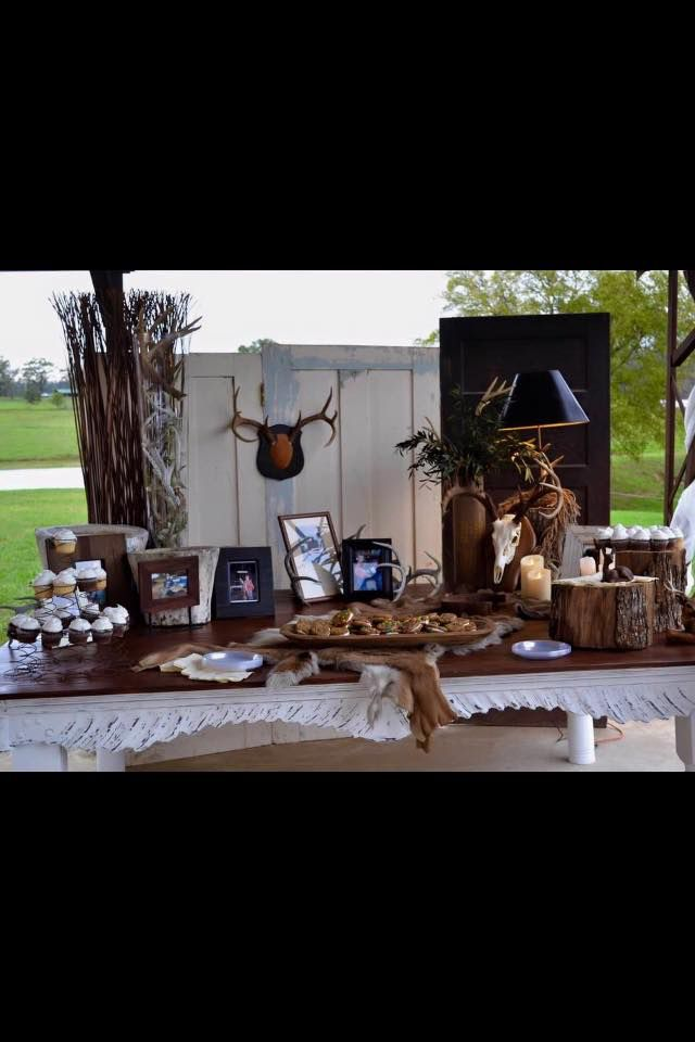Grooms table for the deer hunter! Real horns, pictures, cupcakes and the grooms favorite cookie factory cookies to personalize it!
