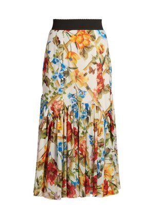 GABRIELLE'S AMAZING FANTASY CLOSET   Dolce & Gabbana's White Midi-Skirt is Printed in Multi-Colored Florals that create a vibrant, festive mood. It's cut from a Silk-Blend with a Black Waistband and a Fitted Hip with a Gathered Second Tier that ends at Mid-Calf. Tuck in the Silk Blouse with Bracelet-Length Balloon Sleeves. Leave the Pussy-Bow Untied. Add a Few Pretty Gold Pieces and finish with Classic Black Pumps and a Box Bag (It's all on this board) This Color lifts all Spirits…