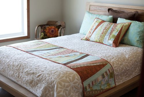 I like the idea of making a bed runner and matching pillows instead of an entire quilt for my bed.