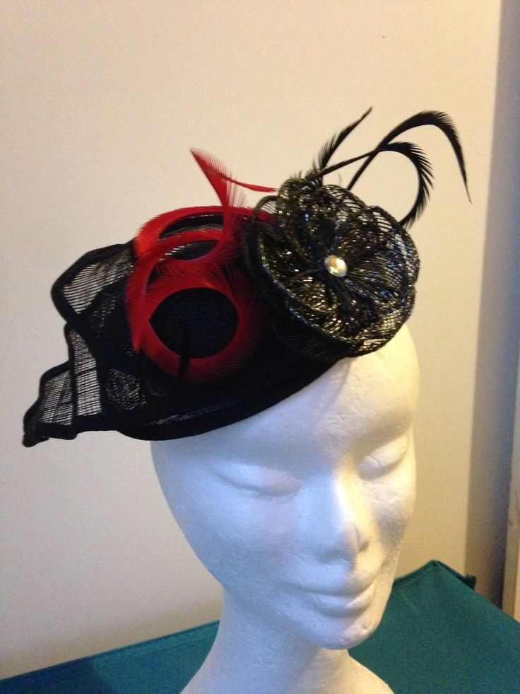 Black with a touch of red, combined sinamay bases with comb