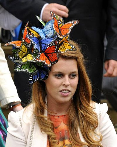 St George's chapel. Peter Phillips and Autumn Kelly marry at Windsor. Princess Beatrice stole the show with this fabulous and fantastic  headgear by Philip Treacy