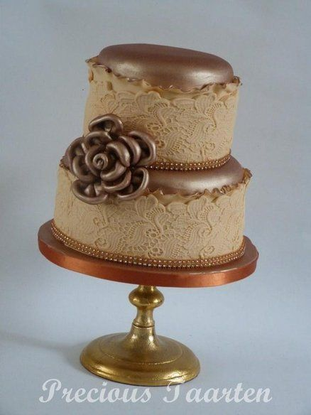 A Two Tier Wedding Cake Fondant Covered Airbrushed In