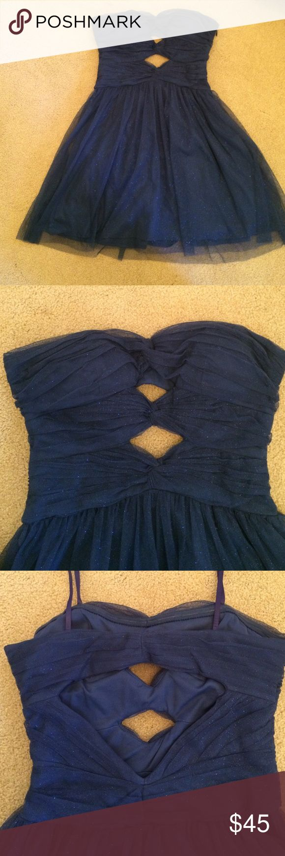 Homecoming dress. Silky material covered in sparkly tulle. Short, simple homecoming dress. Straps attached for hanging up. Hailey Logan Dresses Strapless