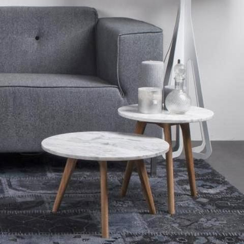 Side tables with white marble on top and treated oak legs. The tablesexists in 3 different sizes.Material: Marble + wood (oak) Measurements:  Small: Ø32x 4