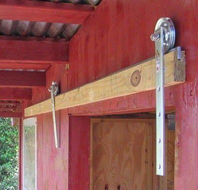 "How to make a Barn DOOR..... 3, 4 ft. strips of flat bar, .25"" x .75"" 2 garage door pulleys  2 mending plates 2 door stops 1 pressure treated 1x6   mending plates were bolted to the pulleys, and screwed onto the door."
