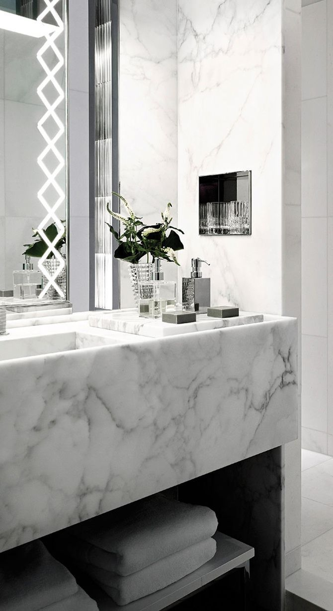 Folded white towels in your home bathroom? Yes, pretty much compulsory for this look.