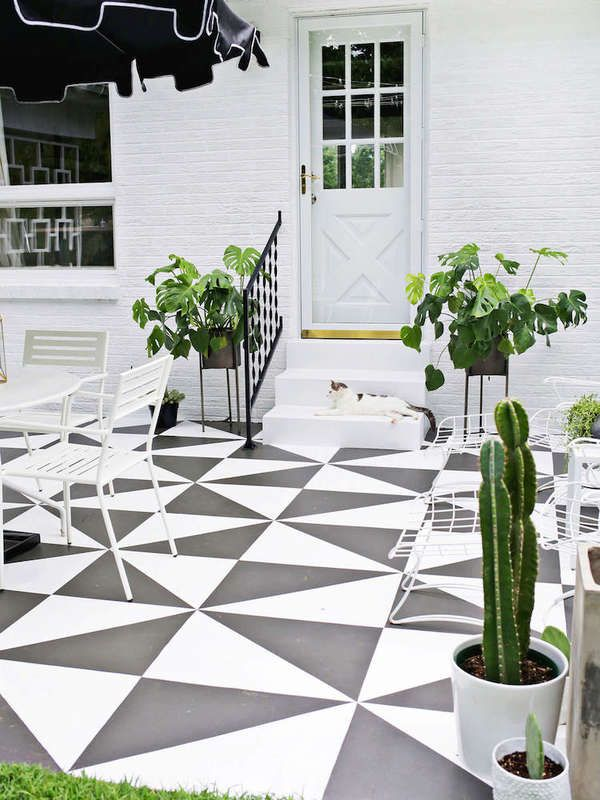 These 8 Home Makeovers Prove The Power Of Paint Paint Concrete Patio Patio Tiles Painted Patio