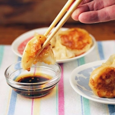 Yum. I would try steaming these in a bamboo steamer rather than fry them. Making dumplings with wonton wrappers is so easy.  Red curry shrimp dumplings