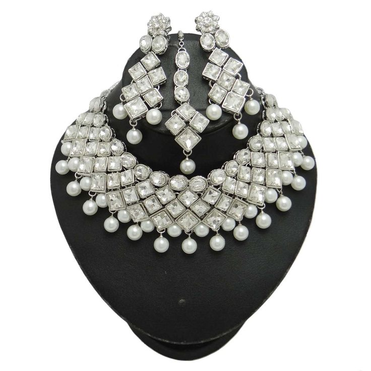 Beautiful pearl work is also done on the set which gives it more royal look. #jewelry
