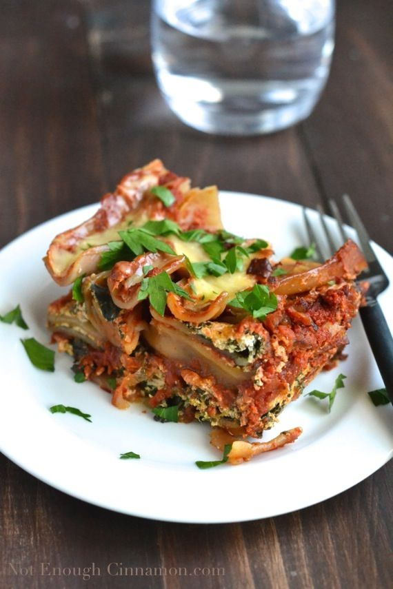 Filled with spinach, ricotta, parmesan and mozzarella cheese, these Skinny Crockpot Lasagna are super easy to make and pure comfort food.