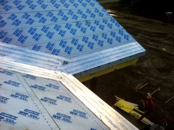 Invizimelt Panels Are Installed Beneath Metal Roof Materials To Provide  Deicing Protection.