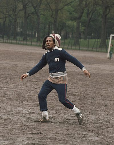 Battersea Park, London, 1975  'Bob used to play football all the time. In London he rented a house in Chelsea with the band. They would come done and play football in Battersea park most days. They would take on anyone; the legend goes that a National Front team came down to the park and the Wailers beat them easily.'  Photograph: Freud PR