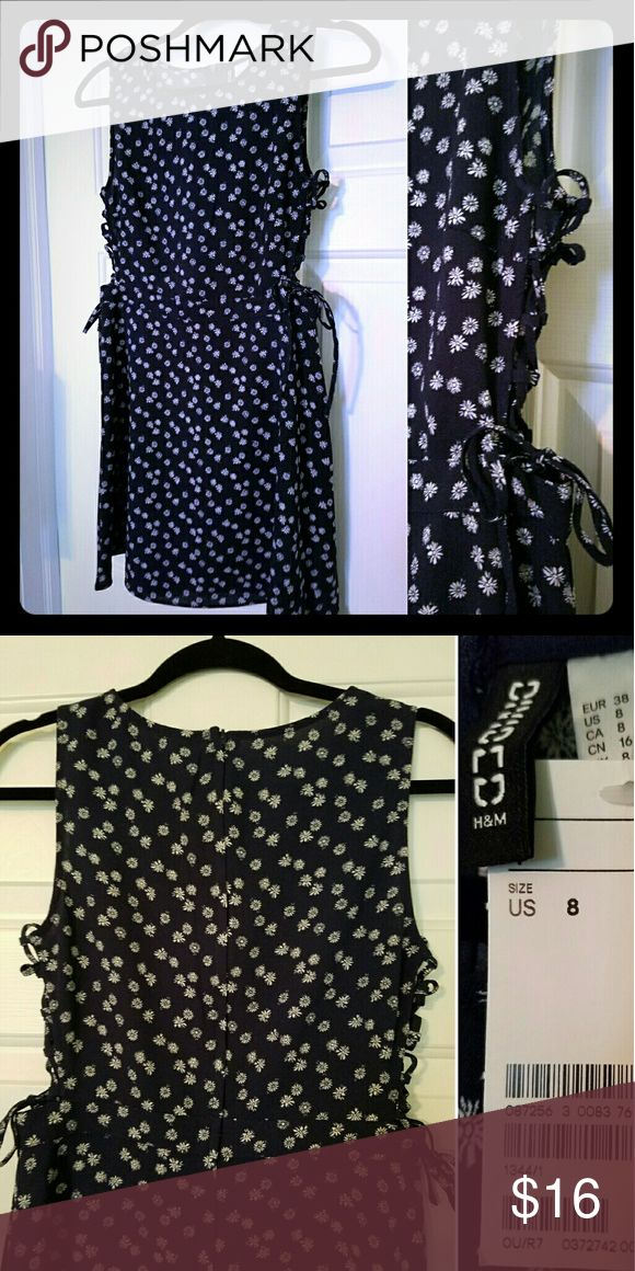 Adorable Floral Skater Dress with Lace-up Sides This navy blue skater dress from H&M is covered in adorable white flowers and zips up the back. The sides lace up and tie in bows that are just so summery and cute. NWT! Divided Dresses Mini