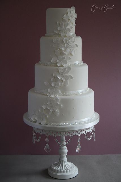"""Another beautiful white on white cake by """"Cotton and Crumbs"""". Love the Swarovski trim over the satin ribbon."""