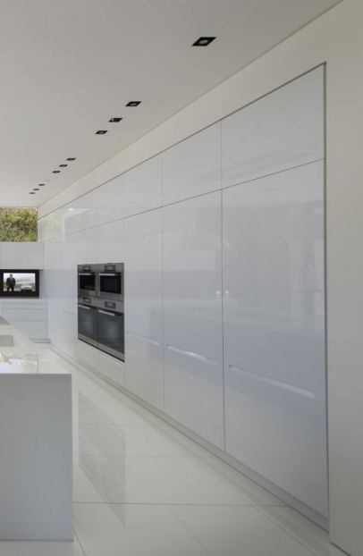High gloss white kitchen, the Laurel Way house in Beverly Hills by Whipple Russell Architects _