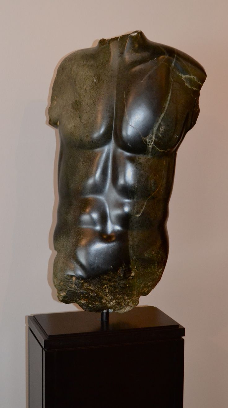 "Evelyne Brader-Frank - Male Torso - Soapstone  ""My sculptures are inspired by the human body. The style of the three dimensional figure I plan to create drives my selection of media. Stone is the warmest of all and this leads to statues that emanate life."""