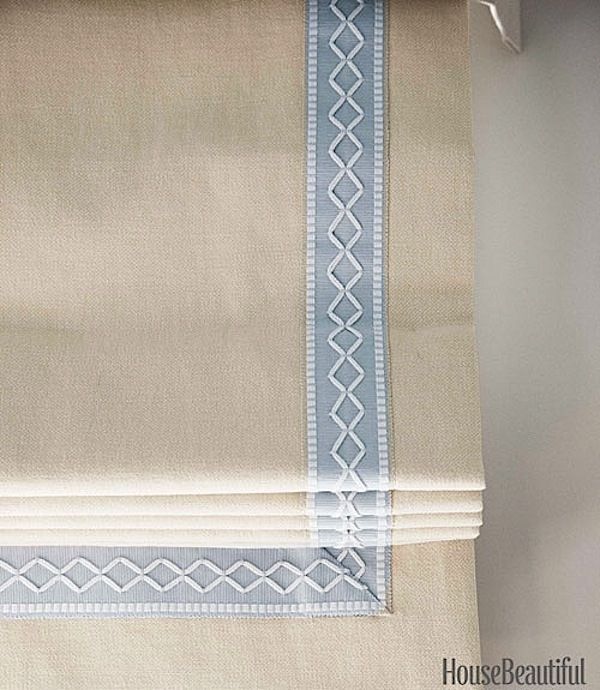 Pretty details such as the Samuel & Sons Oxford Border on the roman shades above make all the difference.