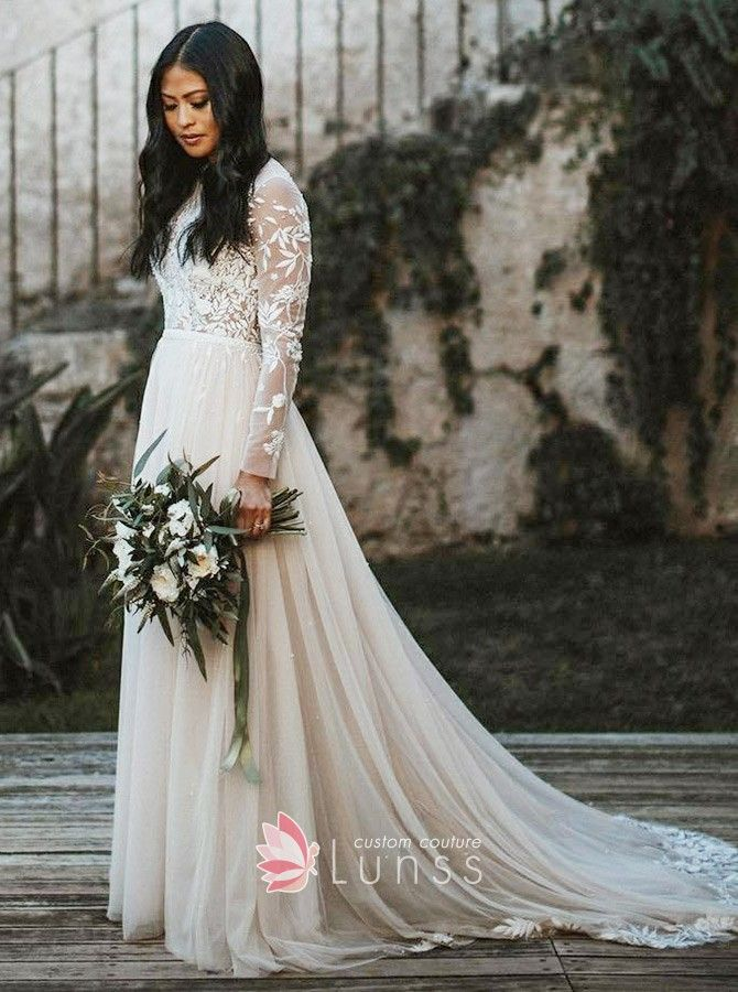 113df6a8ff Vintage inspired ivory lace and tulle long sleeve wedding dress. Illusion  lace appliqued top with